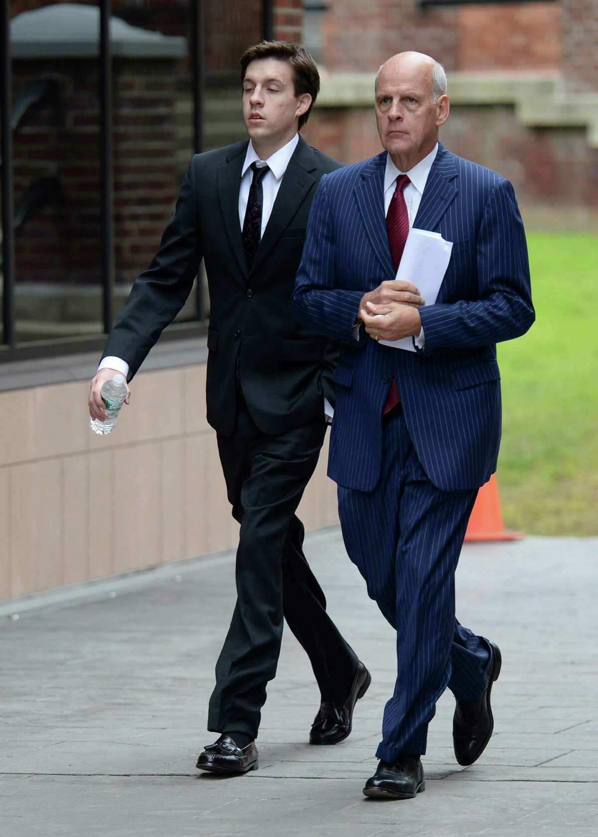 Dennis Drue, left accompanied by his defense attorney Steve Coffey enters Saratoga County Courthouse where he pleaded guilty on Sept. 27, 2013, in Ballston Spa, N.Y. (Skip Dickstein/Times Union)