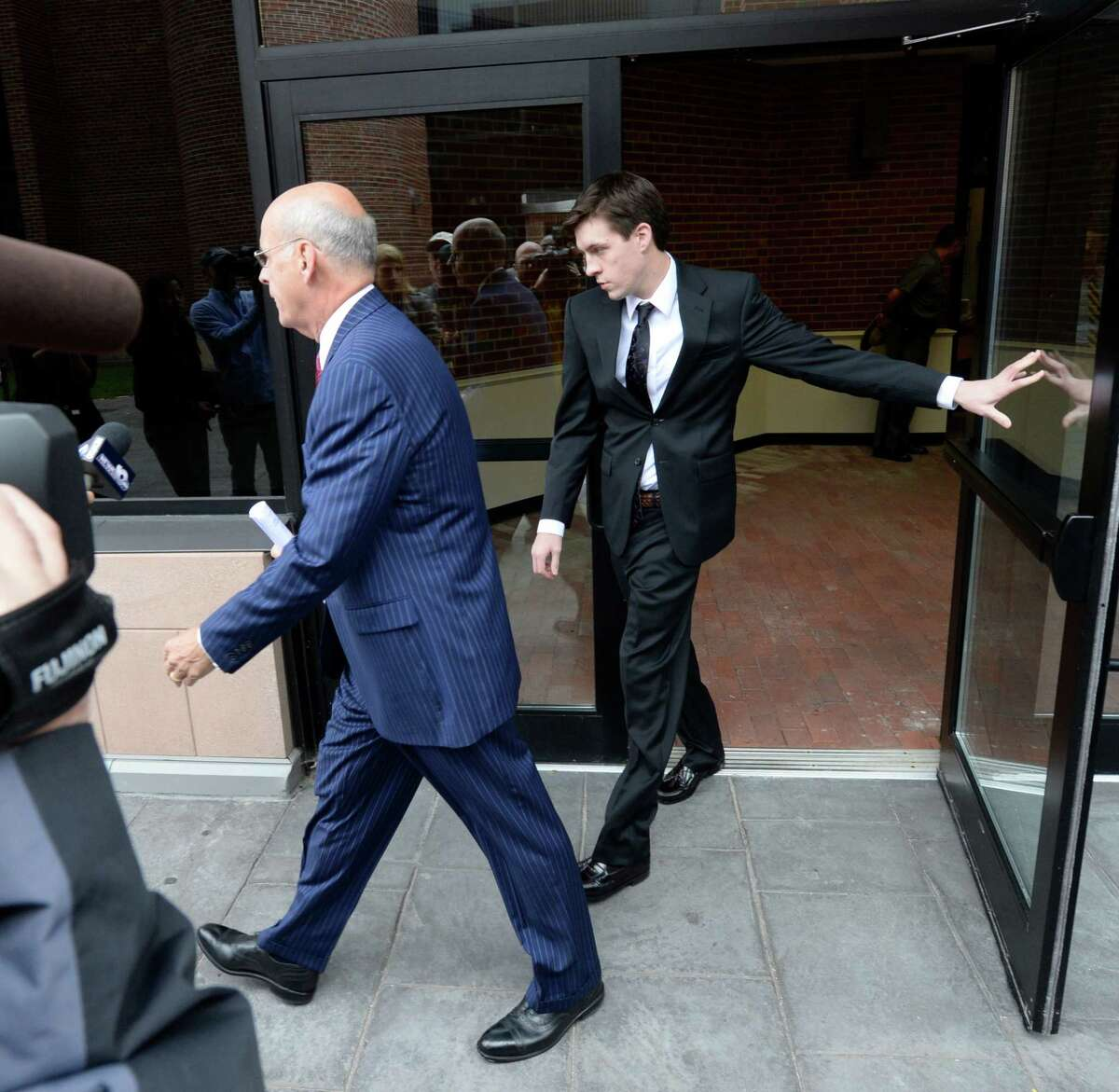 Dennis Drue, right accompanied by his defense attorney Steve Coffey leaves Saratoga County Courthouse where he pleaded guilty Sept. 27, 2013, in Ballston Spa, N.Y. (Skip Dickstein/Times Union)