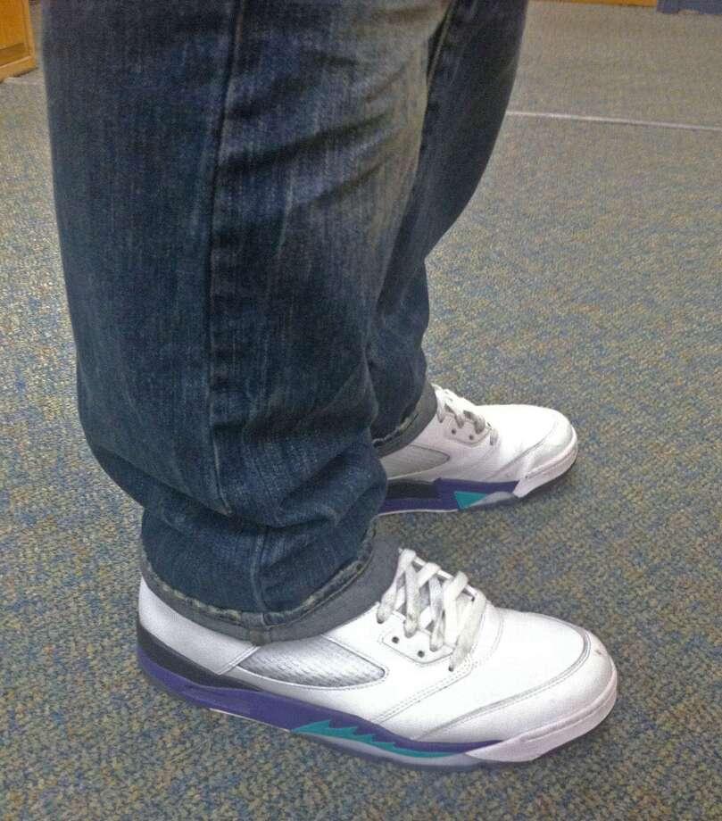 """Michael DiCocco, 17, wears the Retro Air Jordan 5 """"Grapes."""" Photo: Lucas Curtin"""