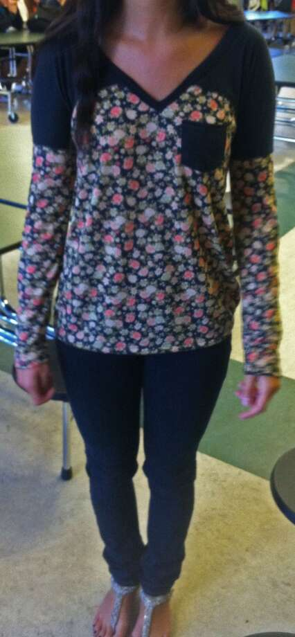 Julie Moran, 17, wears a long sleeved floral patterned shirt with black jeans and silver-plated sandals. Photo: Lucas Curtin