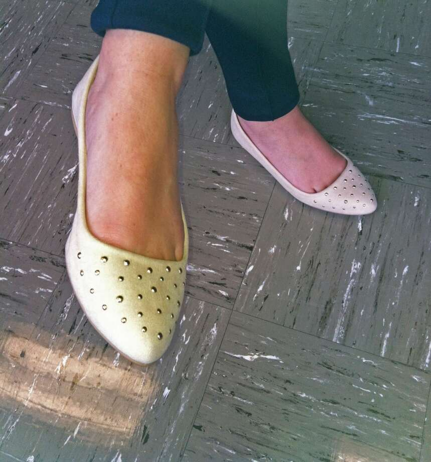 Kristen Roddy, 12th Grade, rocks Charolette Russe pointed toe flats- a comfortable alternative to pointed toe heels. Photo: Olivia Dunn