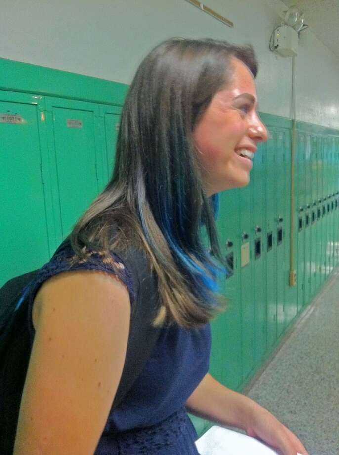 Senior Natalie Horgan shows off her dip dyed hair while talking to other students. Photo: Olivia Dunn
