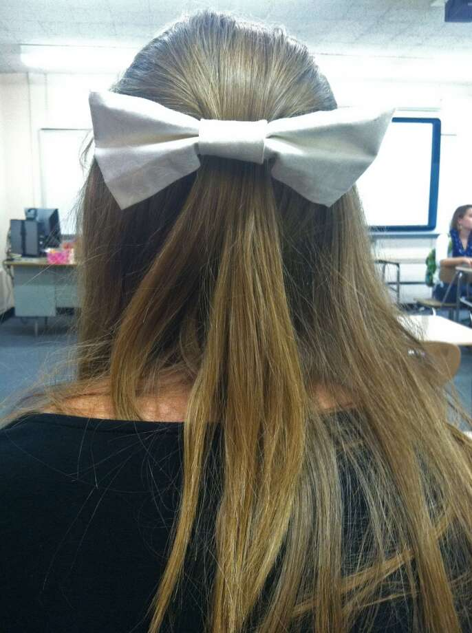 : Megan Hardy, grade 11, was inspired by magazines and other people to create her own DIY hair bow! Discover how to make your own here! (http://youtu.be/9Or3QTBmIKw). Photo: Olivia Dunn