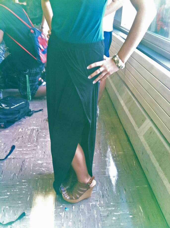 Senior Jenna Grady pairs the trendy maxi skirt with wedge heels. Photo: Olivia Dunn