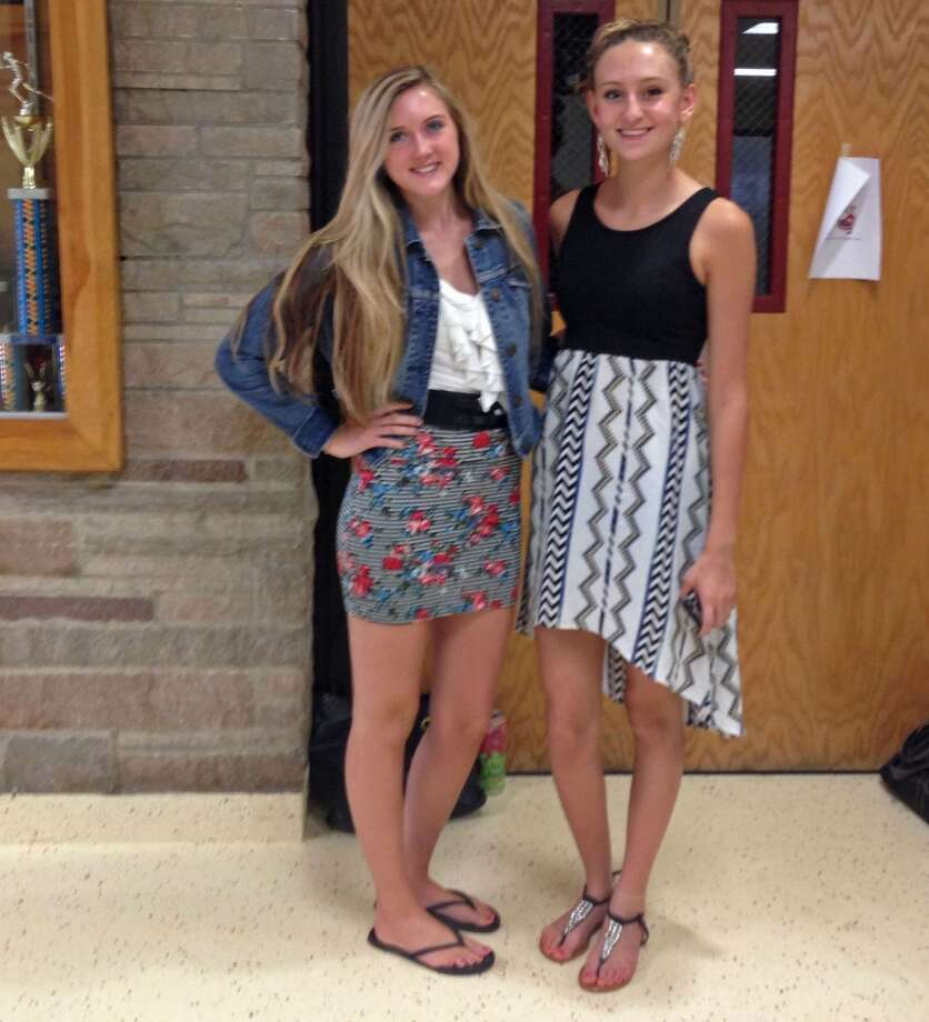 Meghan Vinehout, 17 and Jade Thomspon, 16, at Berne-Knox-Westerlo wearing varieties of skirts. A floral pencil skirt on the left and a patterned high-low skirt on the right. Photo: Audrey Goodemote