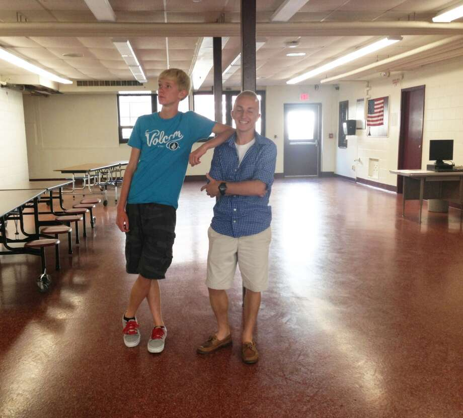 Trevor Brown, 17 wearing a Volcom graphic t-shirt and gray Vans and Travis Fairlee, 17 wearing buttom-up shirt and Sperry top-siders at Berne-Knox-Westerlo. Photo: Audrey Goodemote