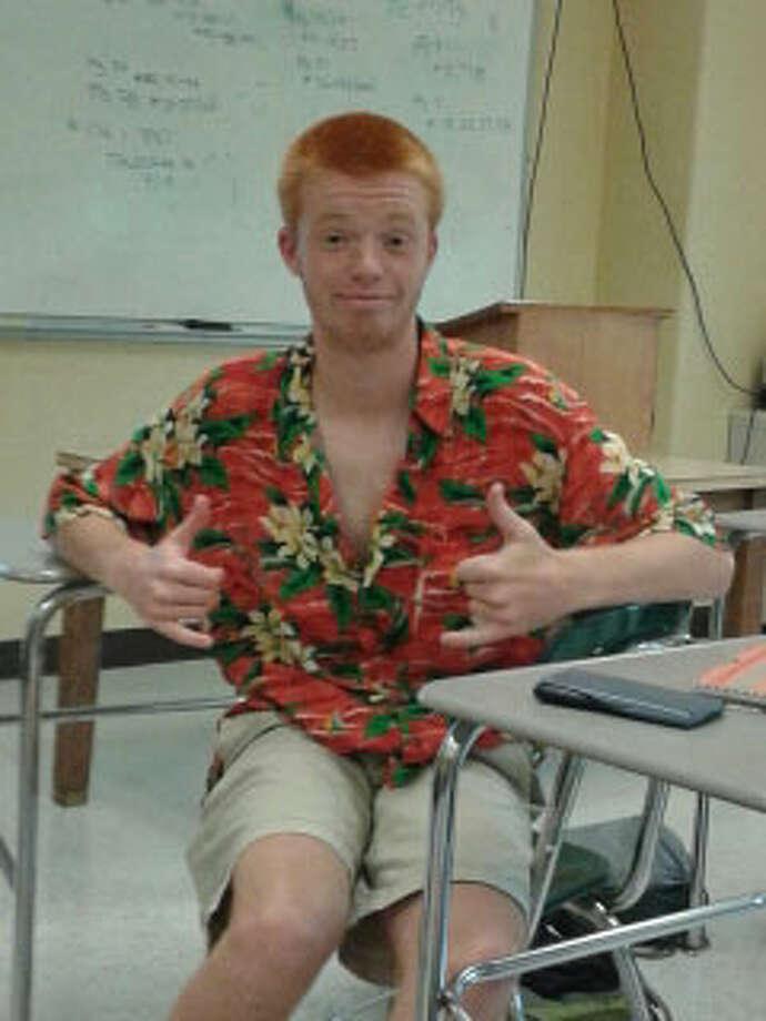 17 year old Middleburgh student  Asa Snyder rocks a bright orange hawaiian shirt and khaki shorts. Photo: Chloe Snyder