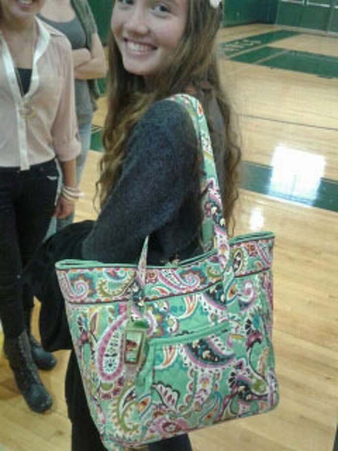 "Middleburgh junior Hailey Gilles accessorizes fashionably with a Vera Bradley tote bag featuring the Summer 2013 print ""Tutti Frutti"". Photo: Chloe Snyder"