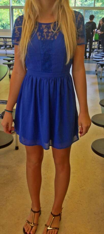 Sarah Ramage, a junior at Schalmont High, is wearing a blue dress with a lace cut-out paired with fashionable sandals. Photo: Courtney Suitto