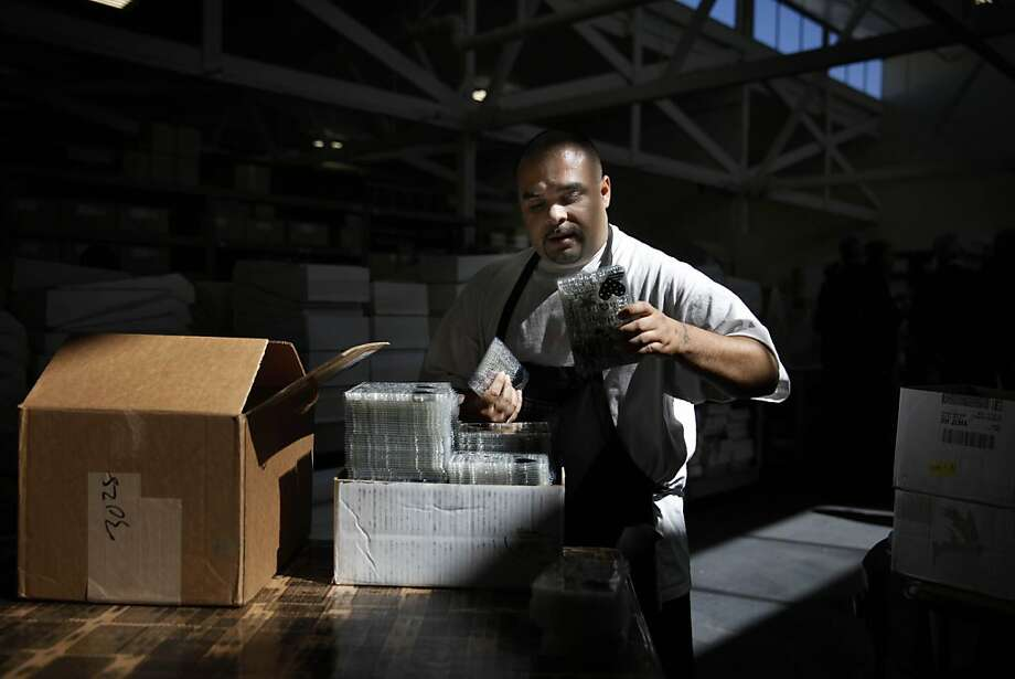 Armando Hernandez distributes clear stamps that will be assembled at Hero Arts' headquarters in Richmond. The Safer Consumer Products Regulations, which take effect Tuesday, are intended to educate consumers about harmful chemicals. Photo: Lea Suzuki, The Chronicle