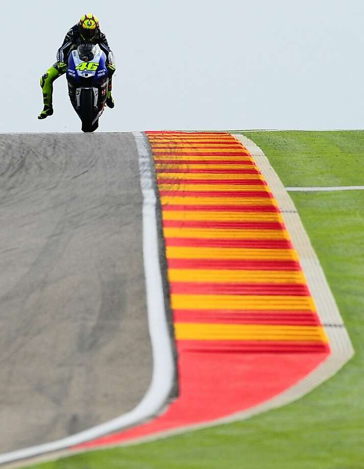 Entering a turn, Italy's Valentino Rossi steers his Yamaha during the second free practice at Motorland racetrack in Alcaniz, Spain. He was to compete in Sunday's Aragon Motorcycle Grand Prix. Photo: Manu Fernandez, Associated Press