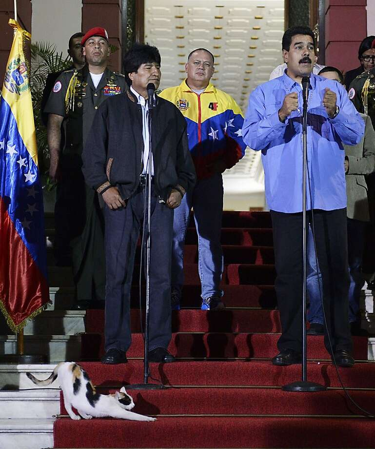 It's customary to kowtowbefore Venezuelan President Nicolas Maduro (right), who was hosting Bolivian President Evo Morales (center) at the presidential palace Miraflores in Caracas. Photo: Juan Barreto, AFP/Getty Images