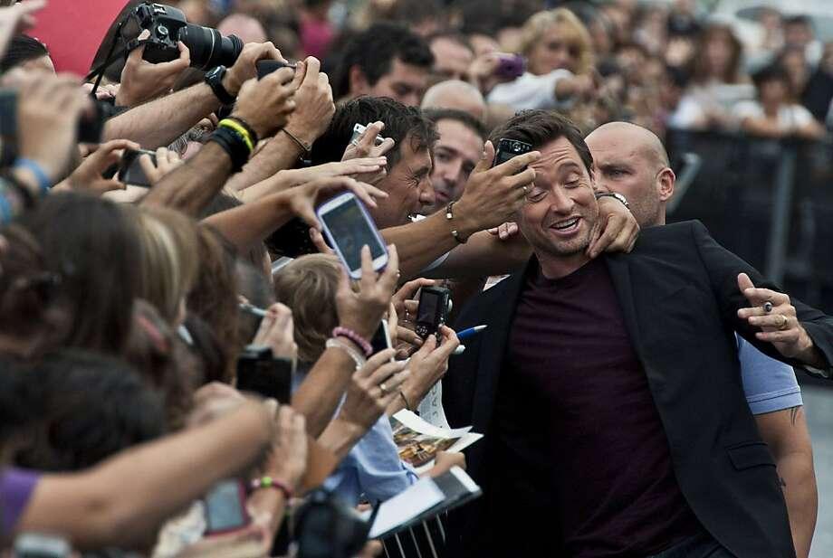 All Hugh needs is love:The bodyguards better usher away Hugh Jackman before his adoring fans hug him to death at Spain's San Sebastian Film Festival. Photo: Alvaro Barrientos, Associated Press