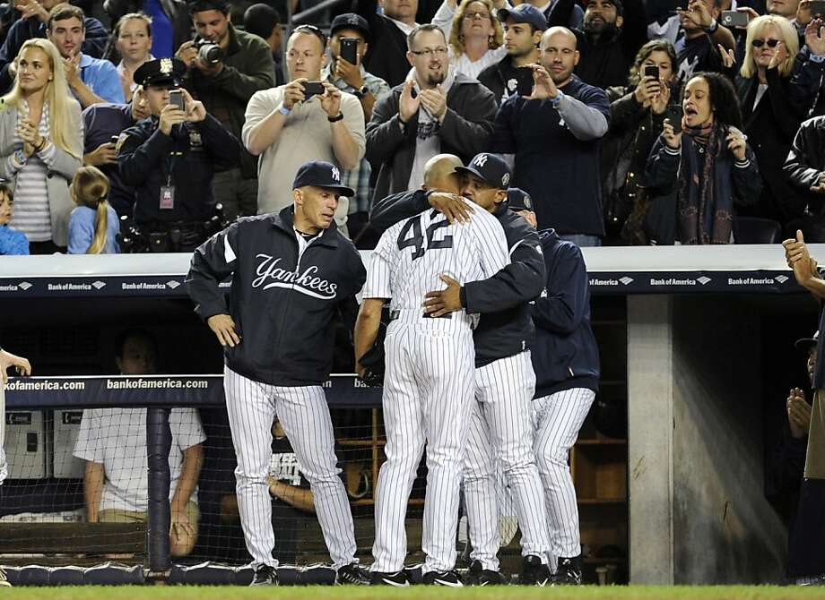 Bronx farewell for the greatest Yankee reliever:Bench coach Tony Pena hugs pitcher Mariano Rivera as the star closer comes out of his final game at Yankee Stadium. Rivera, a future Hall-of-Famer, is retiring at the end of the season. Photo: Bill Kostroun, Associated Press