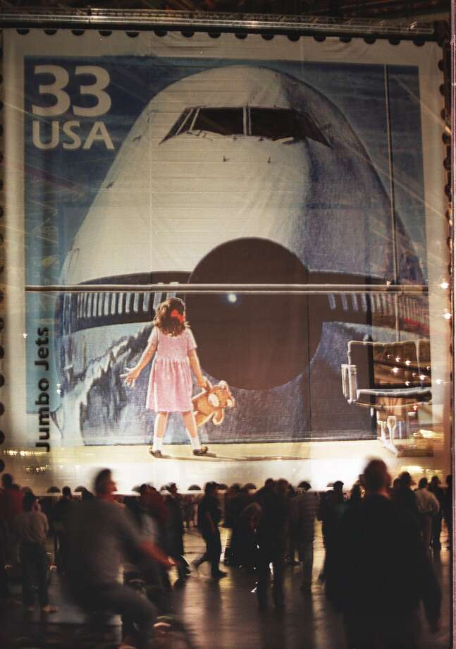 The U.S. Postal service unveiled a Boeing 747 postage stamp in 1999. Boeing affixed a 70-foot image of the stamp on a door of its Everett wide-body plant. Photo: PHIL H. WEBBER