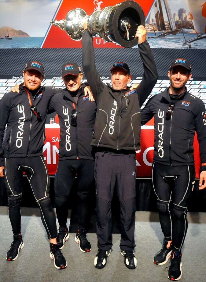 Oracle CEO Larry Ellison holds up the America's Cup trophy alongside Oracle Team USA crew members after winning the 34th America's Cup on September 25, 2013 in San Francisco. AFP PHOTO/Josh EdelsonJosh Edelson/AFP/Getty Images Photo: Josh Edelson, AFP/Getty Images