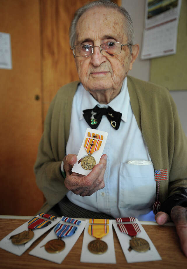 William Benedetto, a resident of St. Joseph's Center in Trumbull, shows the five World War II medals that he received posthumously for his brother Michael, an aircraft mechanic and propeller specialist in the Pacific theater. Photo: Brian A. Pounds / Connecticut Post