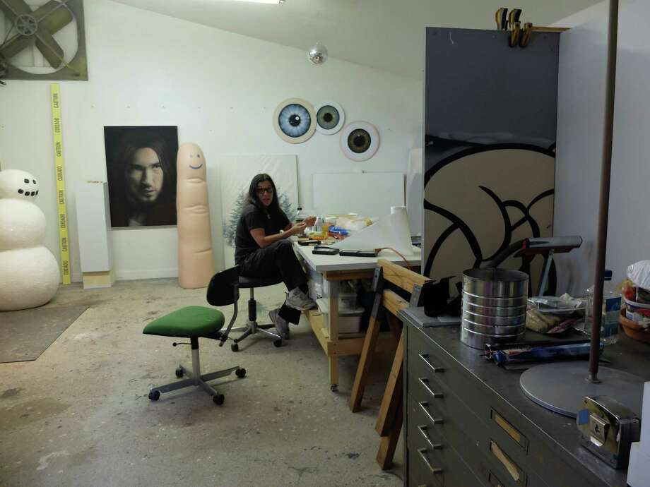 Rachel Hecker at work in her Heights studio. Photo: Molly Glentzer