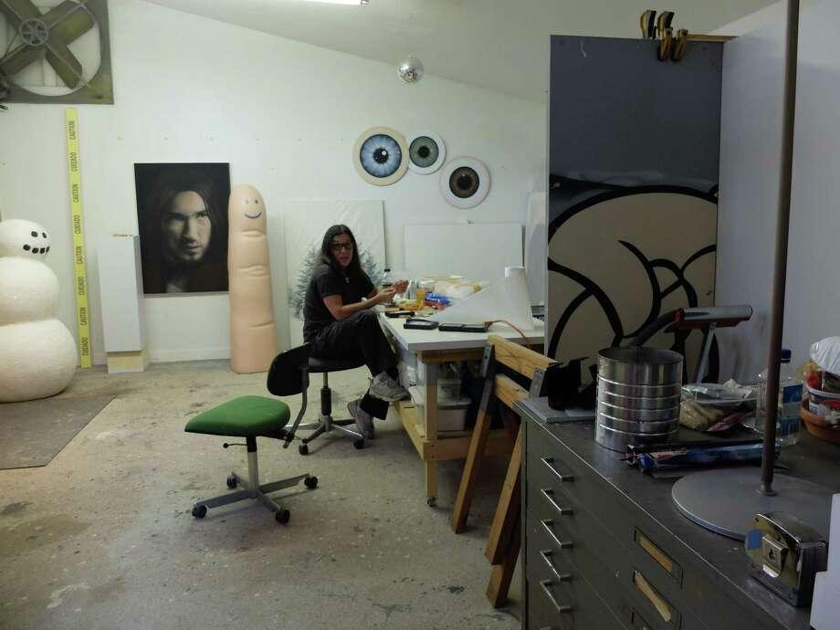 Rachel Hecker at work in her Heights studio. Photo: Molly Glentzer