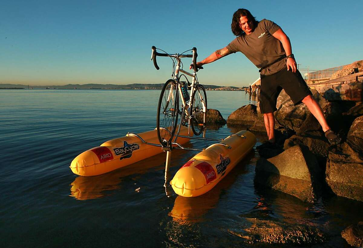 Founder Judah Schiller of BayCycle Project gets ready to launch his bike on a pedal powered flotation from Port View Park in Oakland, California, to the San Francisco Ferry building on Friday, September 27, 2013. He is the first person to bike across the San Francisco bay.
