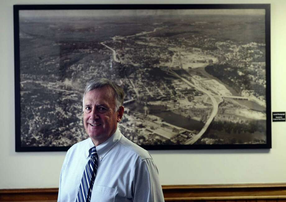 Mayor James DellaVolpe stands in front of an aerial photograph of the Valley Friday afternoon Sept. 27, 2013 at Ansonia City Hall.  The picture was donated Thursday night by Frank and Sheri Parda. Photo: Autumn Driscoll / Connecticut Post