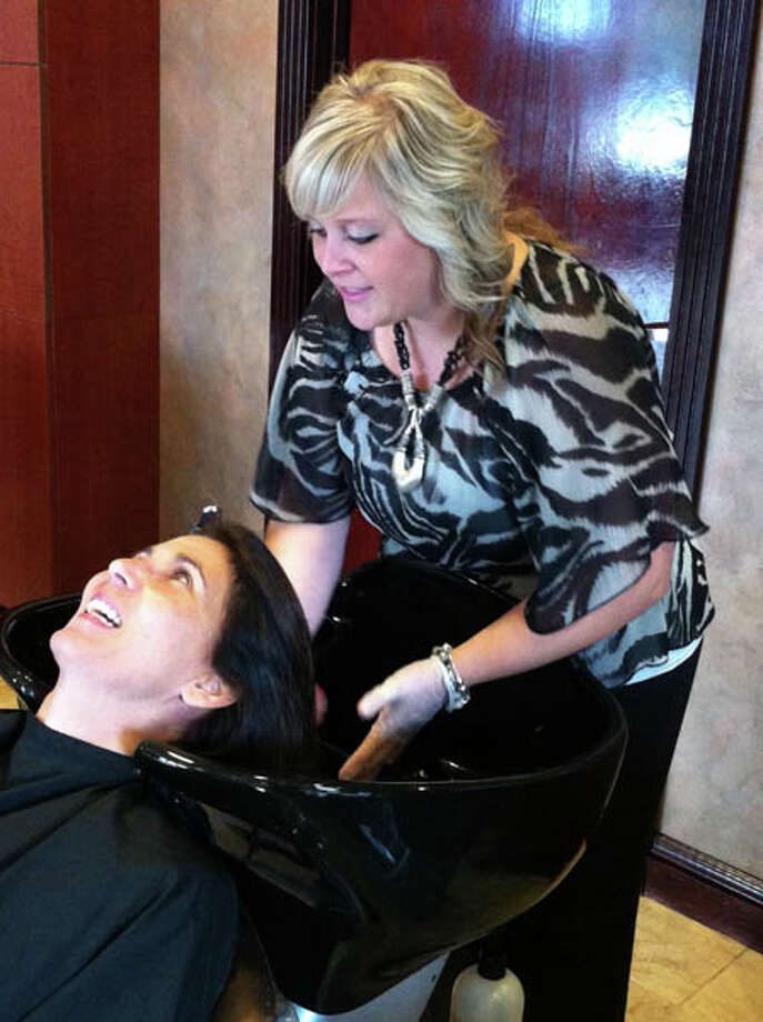 Dona getting her hair done for the cover shoot at Kimberley's A Day Spa in Latham. Photo: Photo By Janet Reynolds/Healthylife