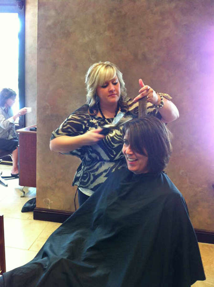 Dona getting her hair done for the cover shoot at Kimberley's A Day Spa. Photo: Photo By Janet Reynolds/Healthylife