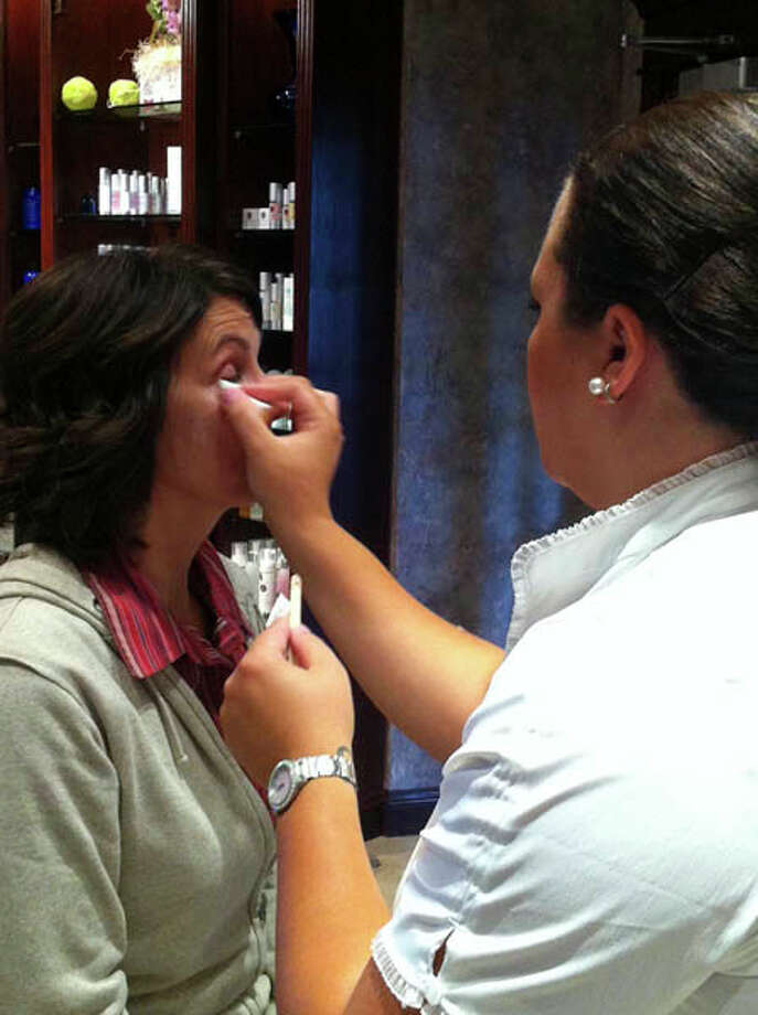 Dona getting her makeup done for the cover shoot at Kimberley's A Day Spa. Photo: Photo By Janet Reynolds/Healthylife