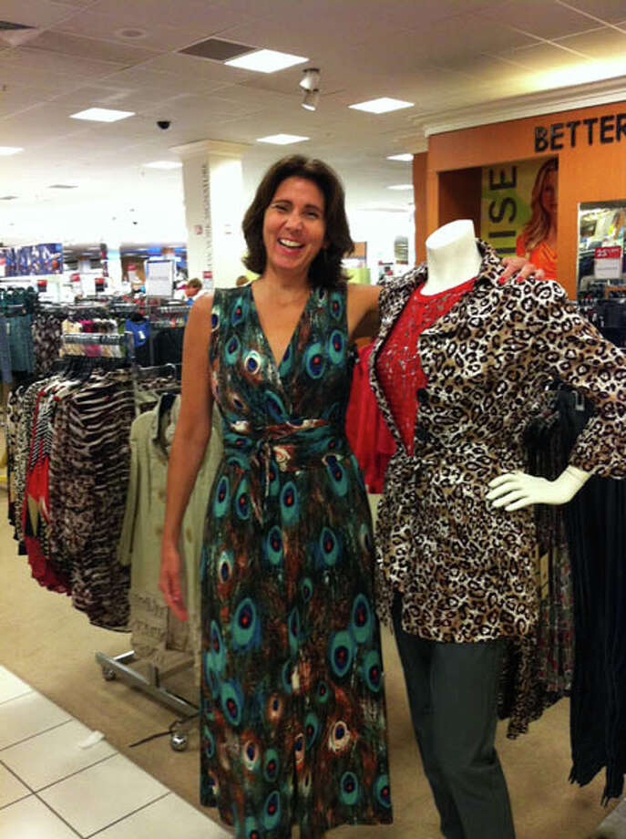 Dona tries on some outfits at Boscov's Clifton Park for the cover shoot. Photo: Photo By Janet Reynolds/Healthylife