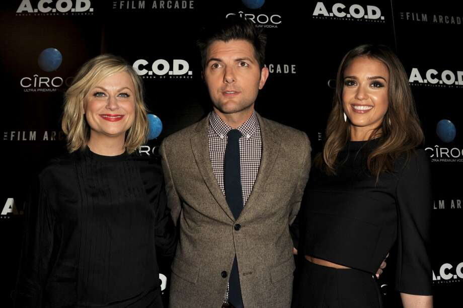 "(L-R) Actors Amy Poehler, Adam Scott and Jessica Alba attend the premiere of the Film Arcade's ""A.C.O.D."" at the Landmark Theater on September 26, 2013 in Los Angeles, California.  (Photo by Kevin Winter/Getty Images) Photo: Kevin Winter, Getty Images"