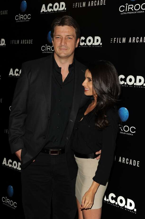 "Actors Nathan Fillion (L) and Mikaela Hoover attend the premiere of the Film Arcade's ""A.C.O.D."" at the Landmark Theater on September 26, 2013 in Los Angeles, California.  (Photo by Kevin Winter/Getty Images) Photo: Kevin Winter, Getty Images"