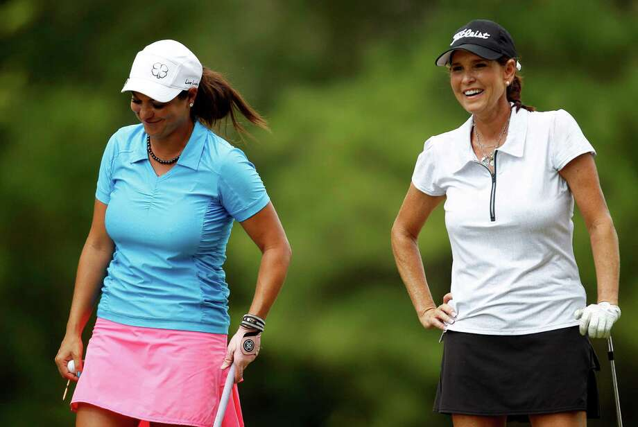Karen Murphy, right, jokes with opponent Jessica Surber on the No. 15 tee after Murphy's tee shot landed within three feet of the hole during the championship match of the Greater Houston Women's City Amateur Championship, Friday, September 27, 2013 at Memorial Park Golf Course in Houston. Murphy defeated Surber, 3&2. Photo: Eric Christian Smith, For The Chronicle