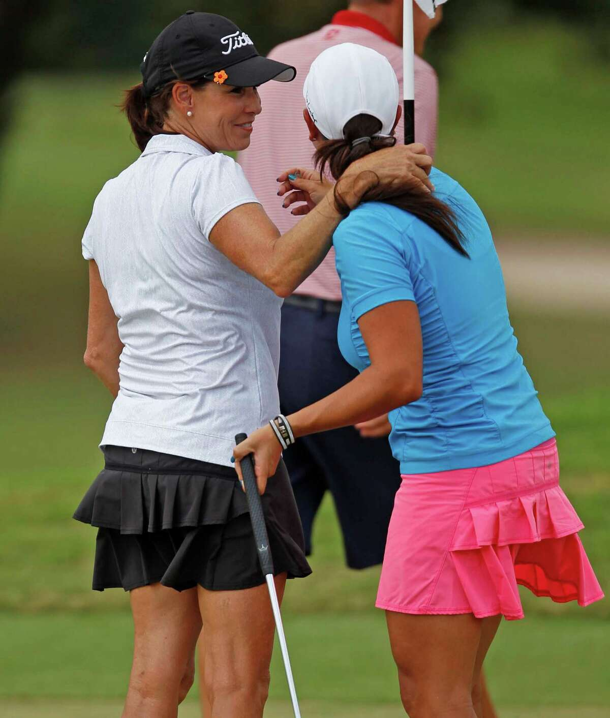 Karen Murphy, left, hugs opponent Jessica Surber on the No. 16 green after Murphy defeated Surber, 3&2, to win the Greater Houston Women's City Amateur Championship, Friday, September 27, 2013 at Memorial Park Golf Course in Houston.