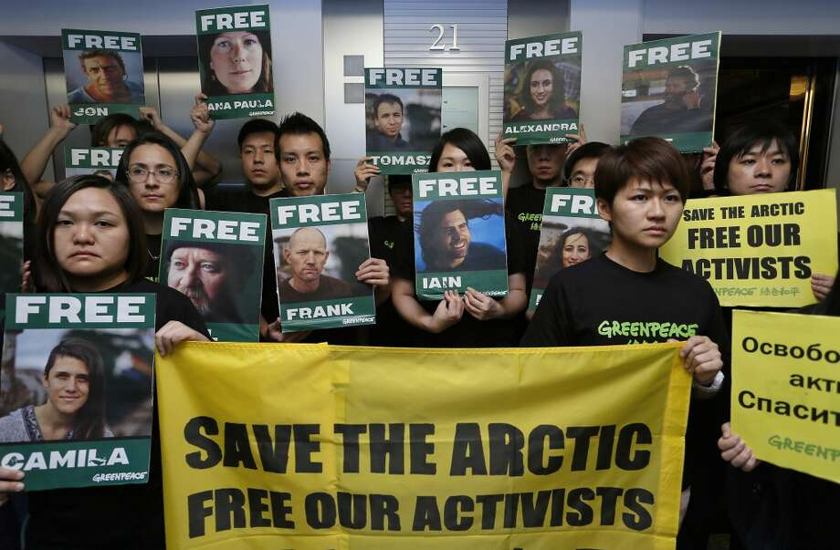 Greenpeace activists demonstrate in front of the Russian consulate general in Hong Kong Friday, Sept. 27, 2013. The activists protested against the rulings of a Russian court that led to the jailing of the environmental group's activists for a protest near an oil platform in the Arctic. Photo: Vincent Yu, Associated Press