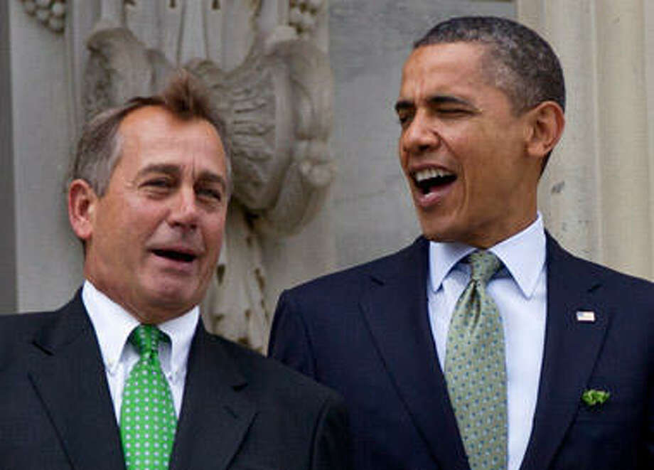 President Obama and Speaker Boehner, seen above in March, staked out some early ground on the fiscal cliff. Photo: Carolyn Kaster, AP Photo / AP2012