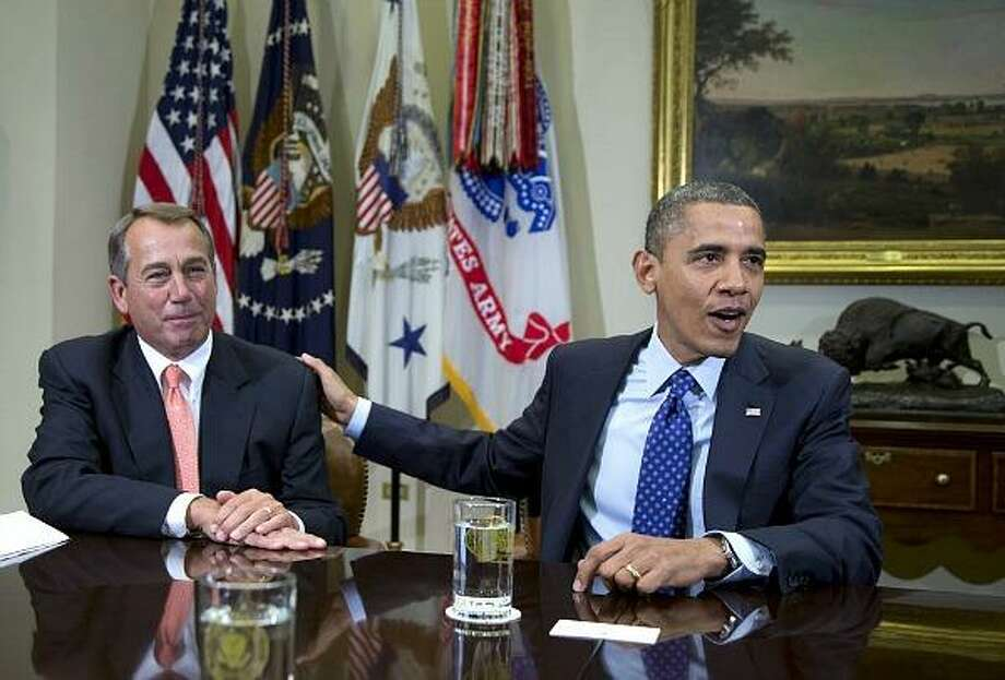 President Barack Obama acknowledges House Speaker John Boehner at the White House in Washington Friday as he hosted a meeting of the congressional leadership to discuss the deficit and the economy. Photo: Carolyn Kaster, AP Photo