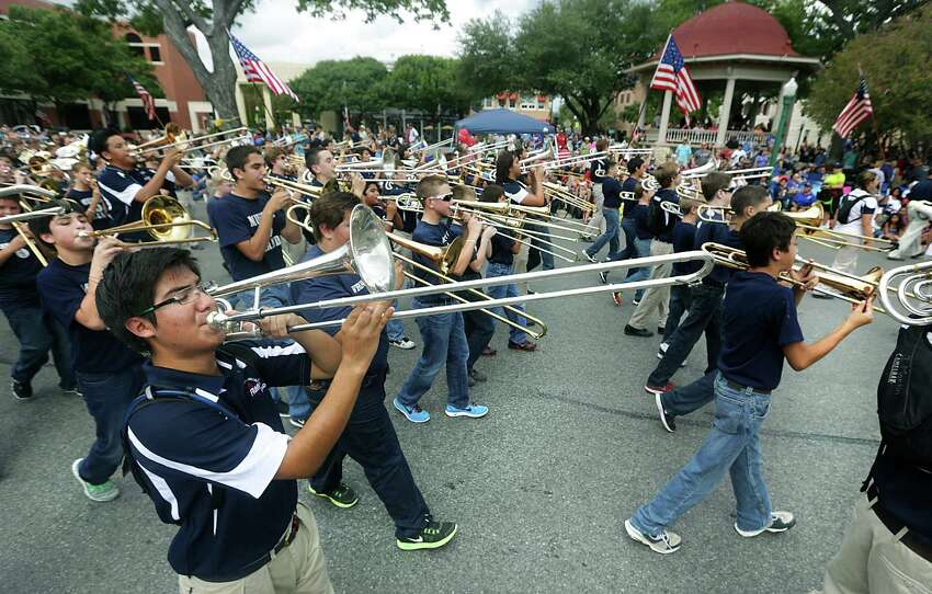 Members of the Smithson Valley High School Marching Band play as they pass the center of New Braunfels during the Comal County Fair Parade, on Friday, Sept. 27, 2013.