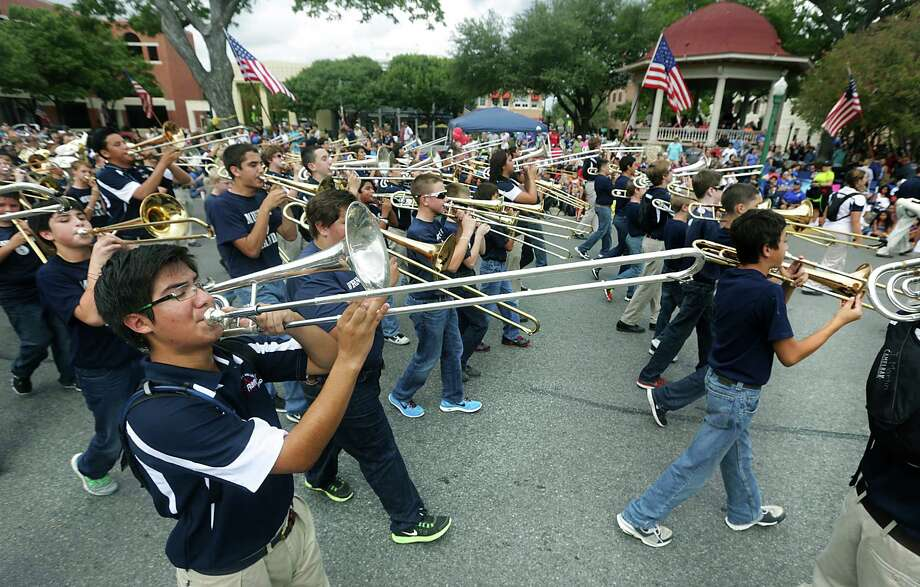 Members of the Smithson Valley High School Marching Band play as they pass the center of New Braunfels during the Comal County Fair Parade, on Friday, Sept. 27, 2013. Photo: BOB OWEN, San Antonio Express-News / © 2012 San Antonio Express-News