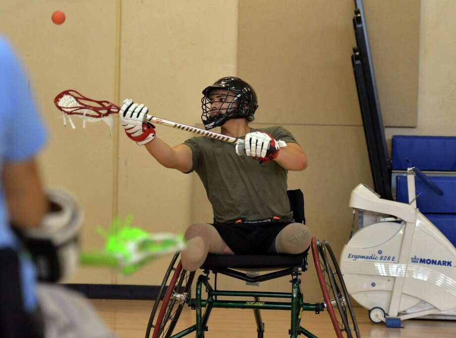 Marine Lance Cpl. Matthew Grashen tries wheelchair lacrosse for the first time. Photo: Washington Post