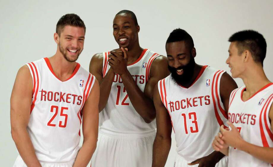 Houston Rockets players, from left, Chandler Parsons, Dwight Howard, James Harden and Jeremy Lin laugh as they pose during NBA basketball media day Friday, Sept. 27, 2013, in Houston. Howard signed with the Rockets in the offseason. (AP Photo/David J. Phillip) Photo: David J. Phillip, Associated Press / AP