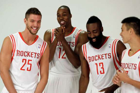 Houston Rockets players, from left, Chandler Parsons, Dwight Howard, James Harden and Jeremy Lin laugh as they pose during NBA basketball media day Friday, Sept. 27, 2013, in Houston. Howard signed with the Rockets in the offseason. (AP Photo/David J. Phillip)