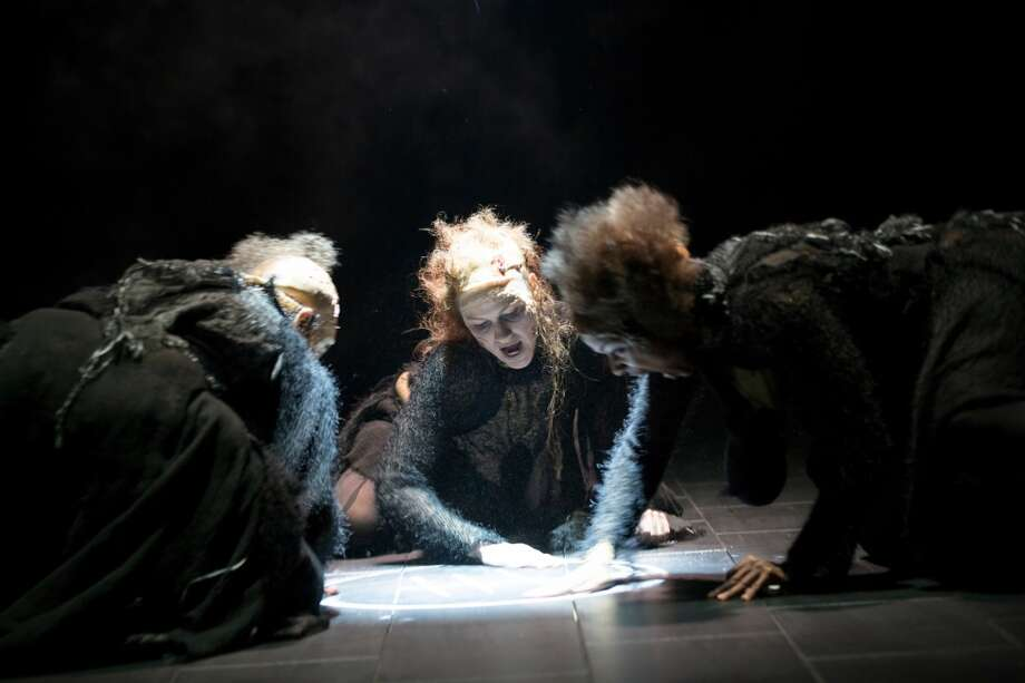 "Kate MacCluggage (center) is alternating her starring role in ""La Dispute"" with multiple supporting roles in ""Macbeth,"" which is running in repertory with the French comedy at Hartford Stage through Nov. 10, 2013. In the above photo she joins the trio of witches in ""Macbeth."" Photo: Contributed Photo"