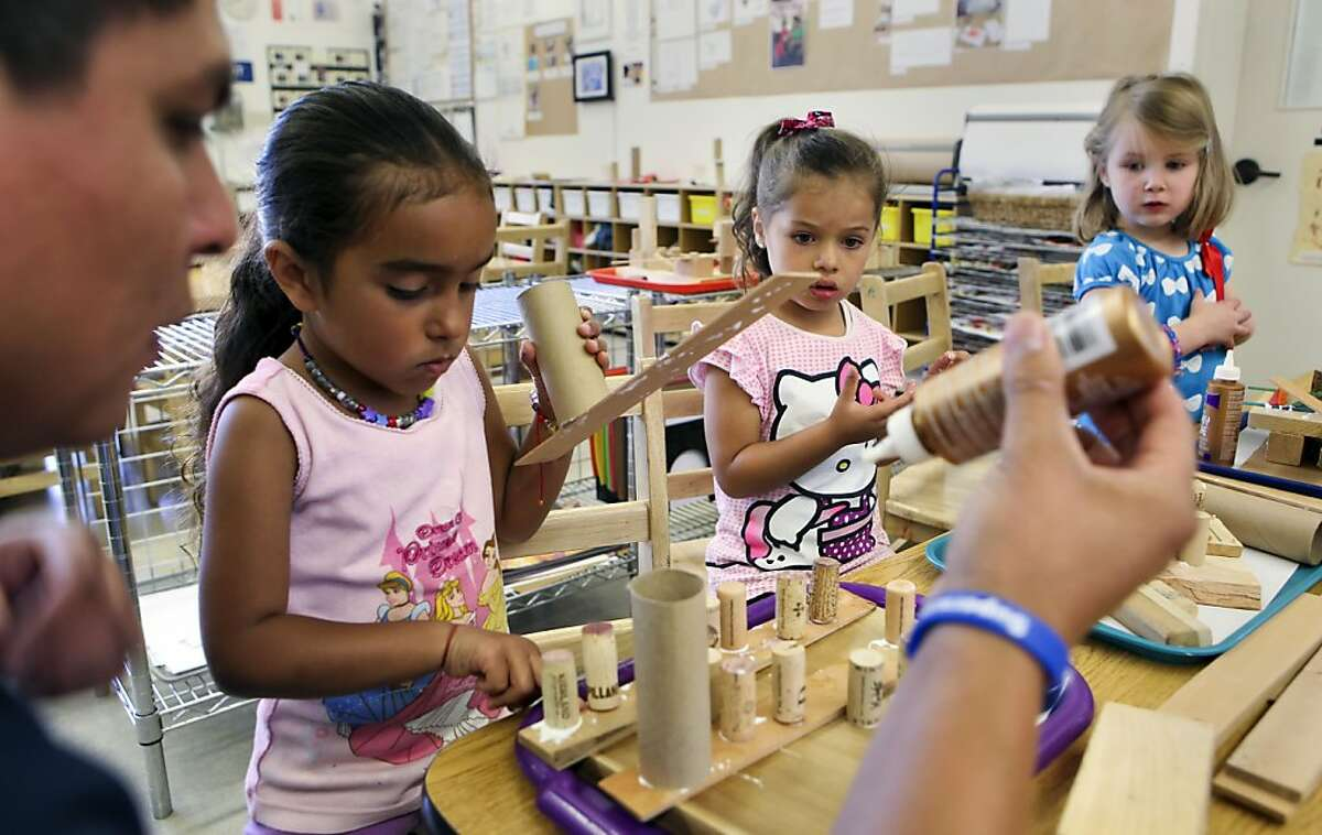 Instructor Oscar Chavez guides students with a hands-on building project at the Zaida Rodriguez early education school in San Francisco, Calif. on Friday Sept. 27, 2013. San Francisco's preschool program is showing evidence that kids who participate are better prepared for kindergarten.