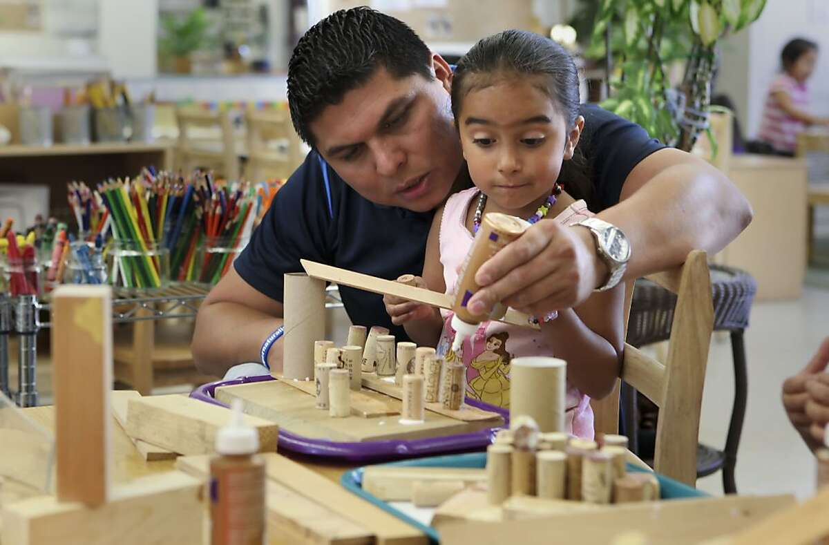 Instructor Oscar Chavez helps a student with a hands-on building project at the Zaida Rodriguez early education school in San Francisco, Calif. on Friday Sept. 27, 2013. San Francisco's preschool program is showing evidence that kids who participate are better prepared for kindergarten.