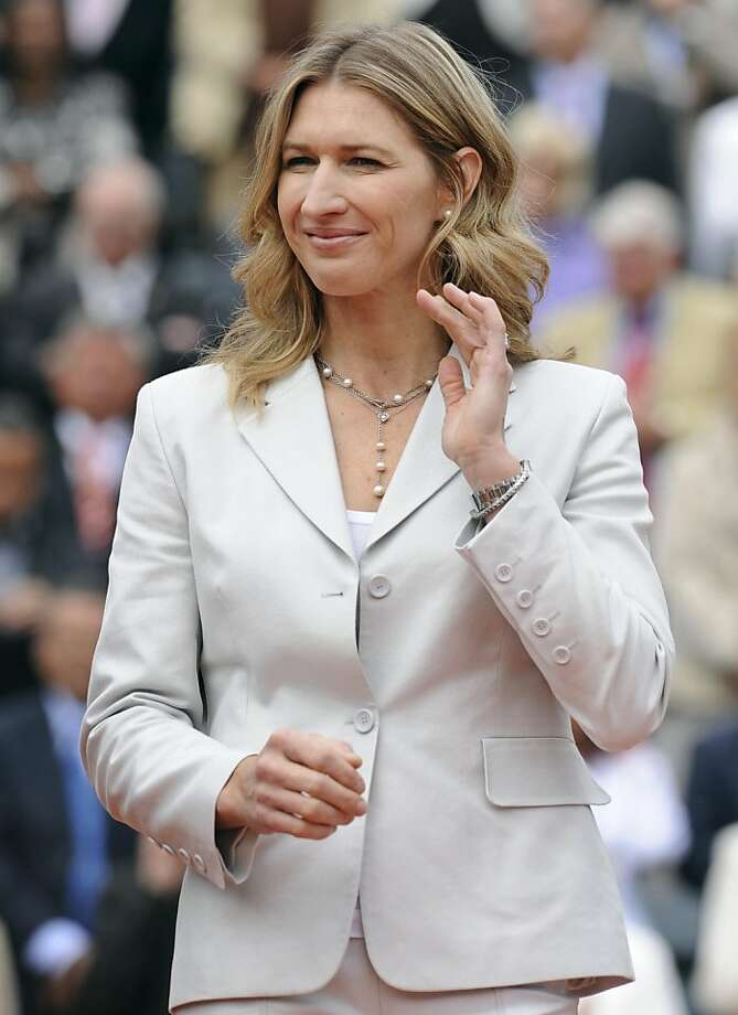 Former tennis international German Steffi Graf stands during the awards ceremony following play between Russia's  Dinara Safina in the French Open tennis final match on June 6, 2009 at  Roland Garros Stadium in Paris. The event, the second Grand Slam  tournament of 2009, runs from May 25 to June 7, 2009. Kuznetsova won  6/4,6/2.  AFP PHOTO / BERTRAND GUAY (Photo credit should read BERTRAND GUAY/AFP/Getty Images) Photo: Bertrand Guay, AFP/Getty Images