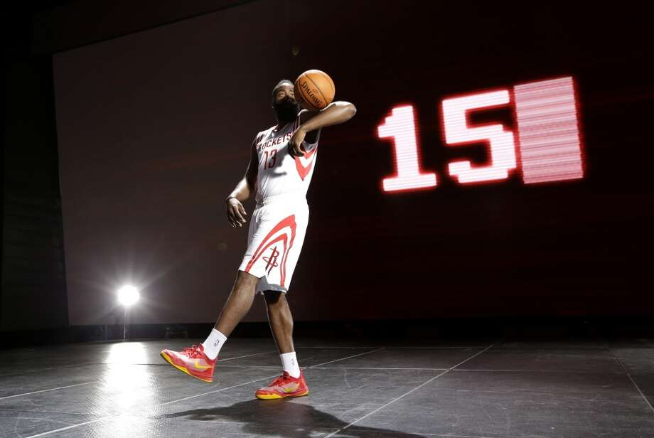 James Harden plays with a ball while being filmed during media day. Photo: David J. Phillip, Associated Press