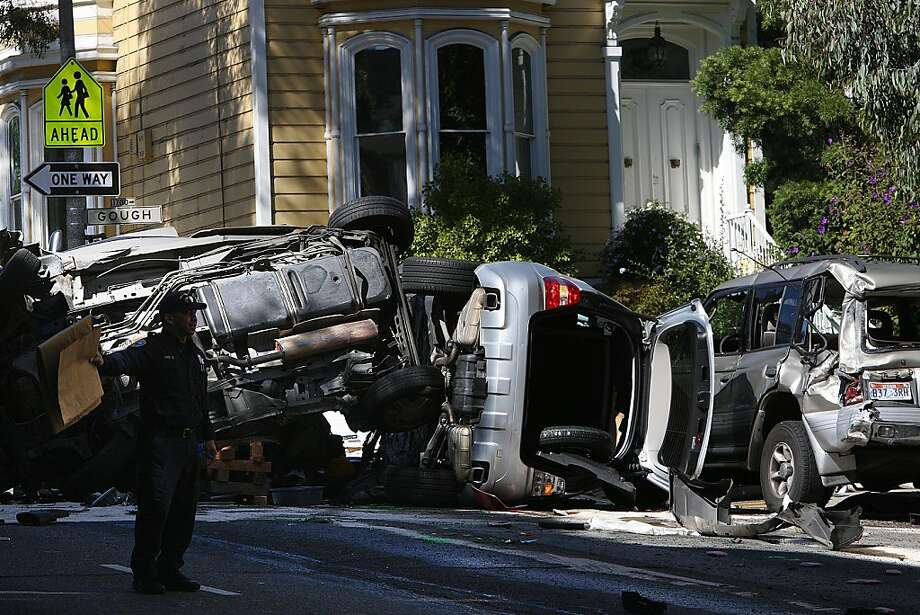 A 17-year-old boy was killed and two others critically injured in a Pacific Heights crash on Pine at Gough streets at around 7:00am in San Francisco, California, when a woman crashed her speeding Mercedes-Benz into a minivan on Friday, September 27, 2013, Photo: Liz Hafalia, The Chronicle