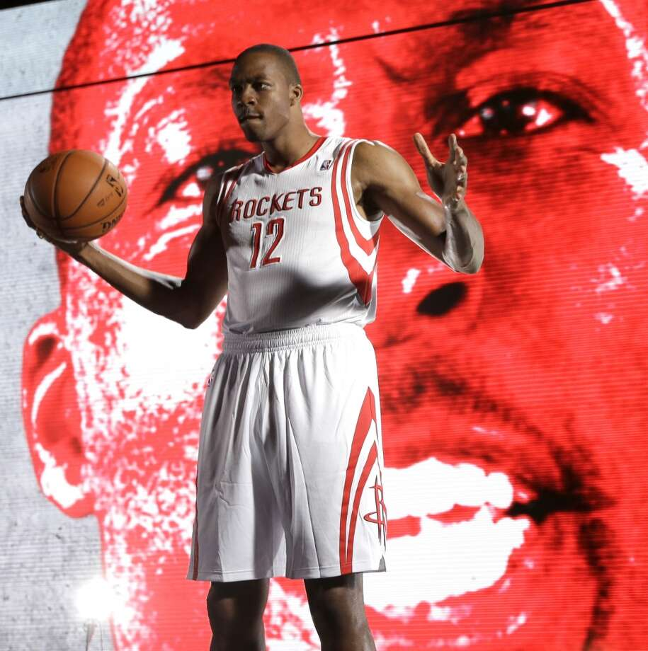 Dwight Howard poses in front of a videoboard. Photo: David J. Phillip, Associated Press