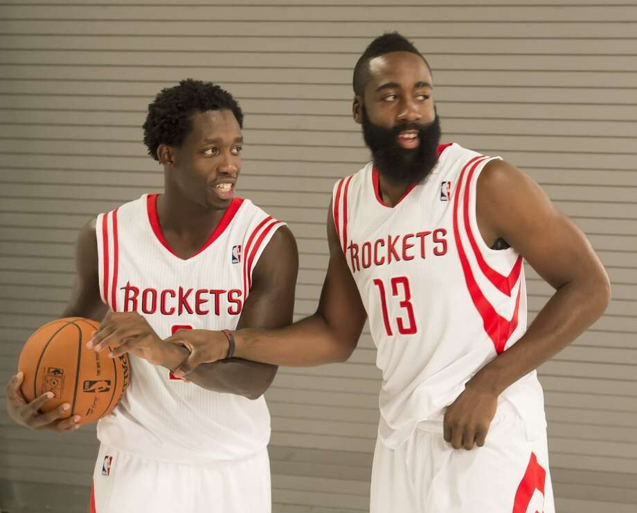 Patrick Beverley, left, and James Harden share a laugh. Photo: George Bridges, MCT