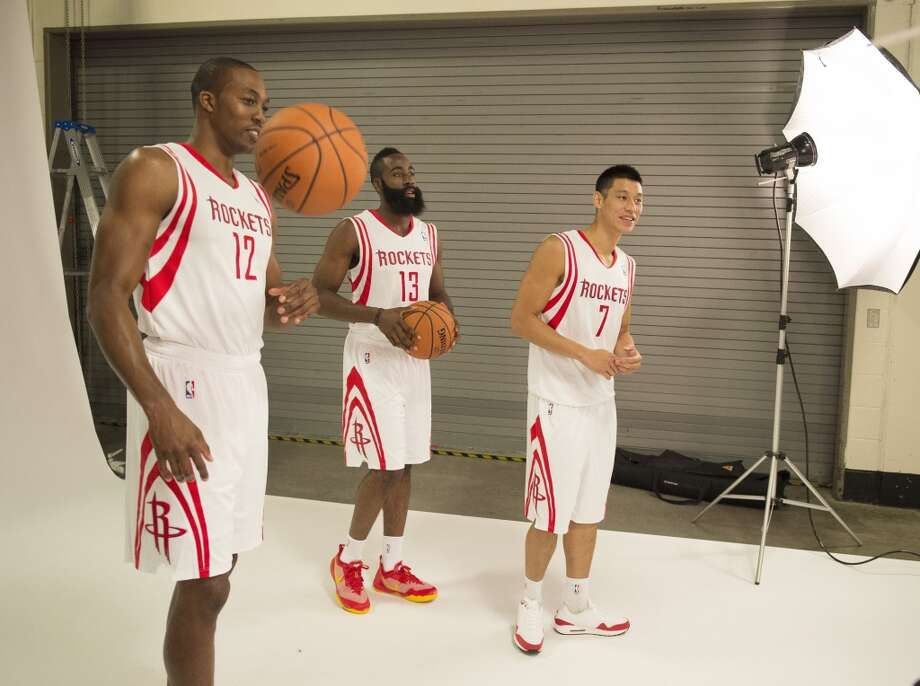 From left: Dwight Howard, James Harden and Jeremy Lin pose for photos. Photo: George Bridges, MCT